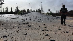 The approach road to Tripoli airport, littered with shells, on 21 August 2014