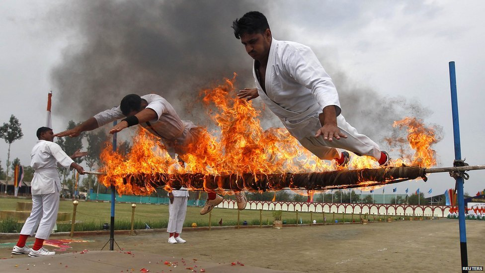 India's Central Reserve Police Force recruits perform a stunt during the passing out parade near Srinagar in Indian-administer Kashmir