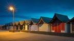 Beach huts in Mablethorpe at night