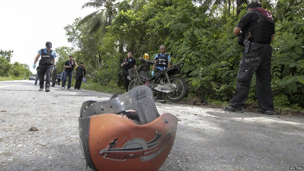 A helmet lies on the site of a bomb attack in Thailand's Pattani province, in which one teacher was killed and two others wounded