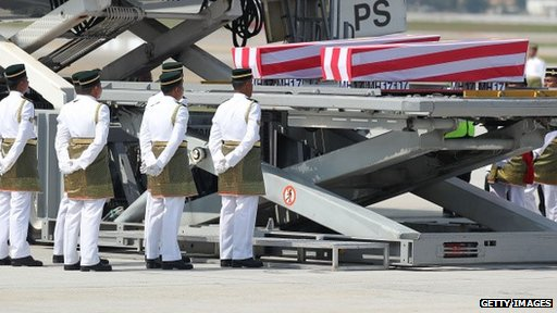 Coffins of victims from MH17 arriving in Malaysia
