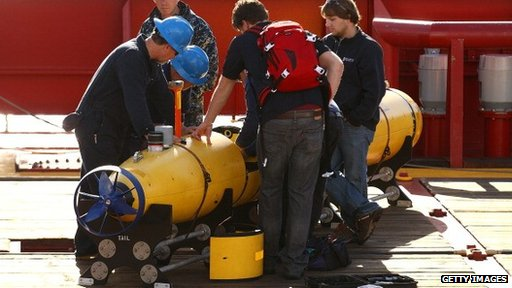 Australian technicians prepare to launch a vessel to search for MH370