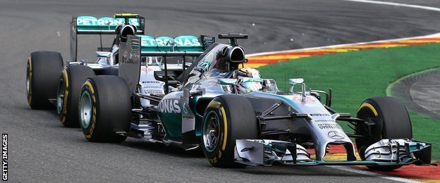 Nico Rosberg and Lewis Hamilton collide at the Belgian Grand Prix
