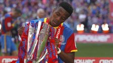 Wilfried Zaha with play-off trophy