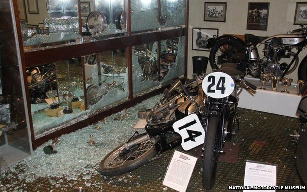 damaged display at national motor cycle museum