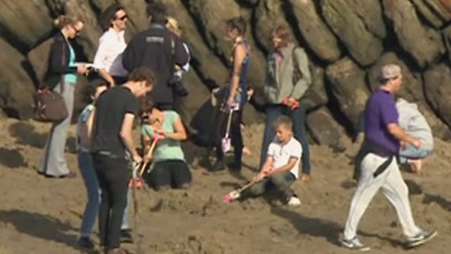 People digging for gold on Folkestone beach