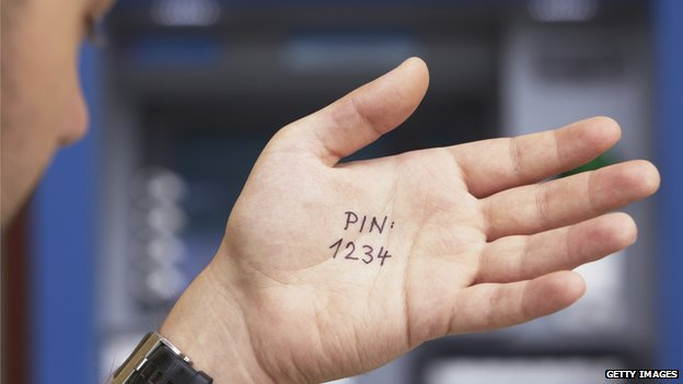 Man's hand with 1234 PIN written on it