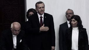 """Turkey""""s new President Tayyip Erdogan (C) attends a swearing in ceremony at parliament (28 August 2014)"""