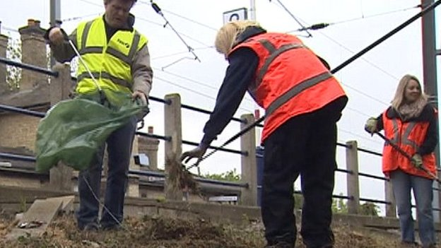 Clear-up work at Shepreth Station where poppies were planted