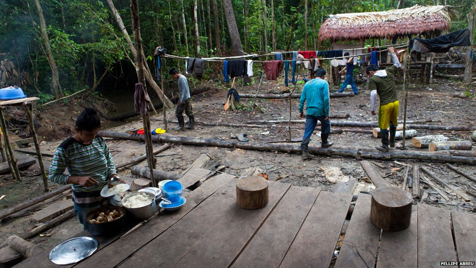 Families cook in a Camp built by illegal loggers in the Peruvian jungle, on the shores of the of the Esperanza river on 3 April 2013.