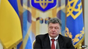 Ukrainian President Petro Poroshenko speaks during the opening of the extraordinary sitting of the National Security and Defence Council in Kiev, 28 August 2014