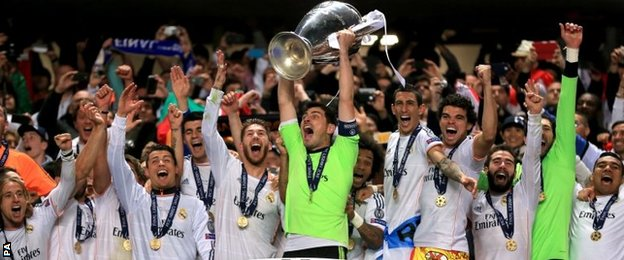Real Madrid players lift trophy