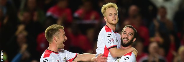 MK Dons celebrate scoring against Manchester United