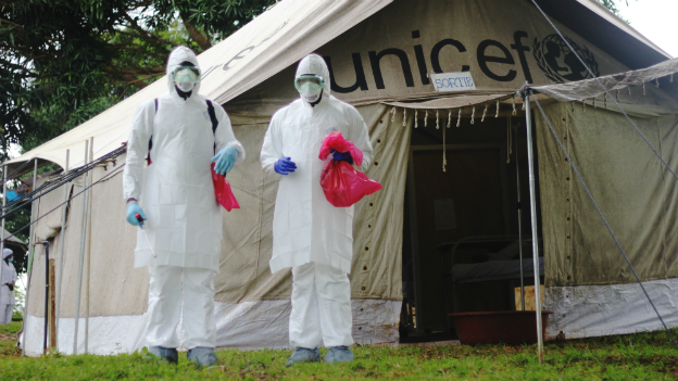 Two doctors during a practice drill for dealing with an Ebola case at Biankouma Hospital in western Ivory Coast - 27 August 2014