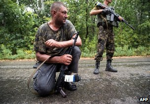 Ukrainian soldiers mount a patrol after being shot at by rebels near Dzerzhynsk in the Donetsk region, 28 August