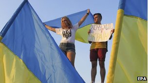 Ukrainians take part in rally in support of their country in downtown Mariupol, Ukraine