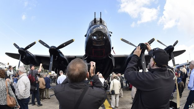 Enthusiasts take pictures of the Lancaster Bomber