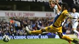 Tottenham Hotspur's English striker Harry Kane scores the opening goal