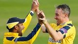 Rikki Clarke of Warwickshire (R) celebrates with team-mate Varun Chopra