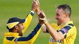 Rikki Clarke of Warwickshire (R) celebrates with team-mate Varun Chopra