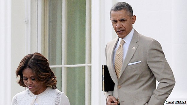 President Obama leaves church on Easter Day 2014 wearing a beige suit.