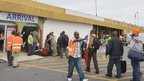 Passengers queue to leave Liberia's  Roberts International Airport near Monrovia (28 August 2014)