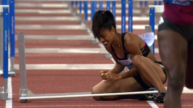 Queen Harrison of the United States after falling in the 100m hurdles at the Diamond League meeting in Zurich