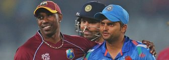 West Indies' Dwayne Bravo and India's Suresh Raina