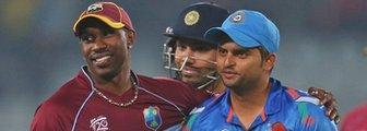 West Indies' Dwayne Bravo and India's Suresh Raina