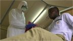 Doctor in West Africa practising treatment for Ebola