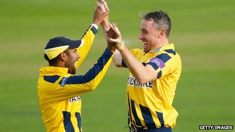 Varun Chopra and Rikki Clarke celebrate a wicket