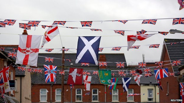 The Scottish saltire flies among other flags in East Belfast