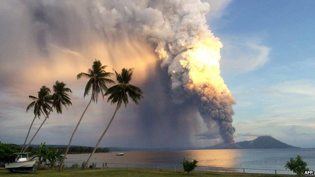A photo taken on 29 August, 2014, shows Mount Tavurvur erupting in eastern Papua New Guinea, spewing rocks and ash into the air, forcing the evacuation of local communities and international flights to be re-routed