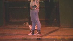 Girl on street late at night