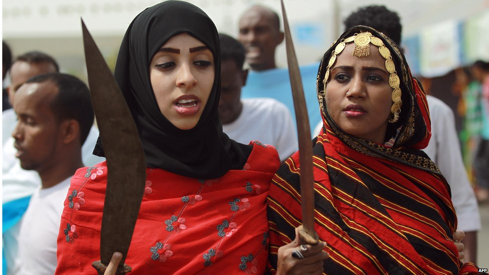Somali women with traditional swords at a cultural festival in Sanaa, Yemen - Sunday 24 August 2014