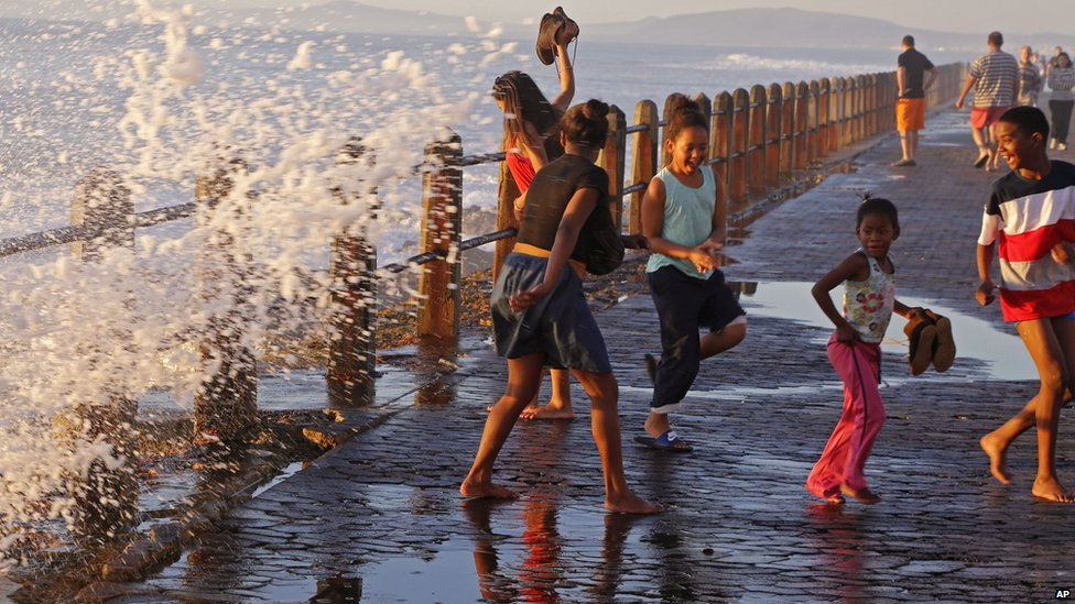 A wave splashing on to the promenade in Cape Town, South Africa - Sunday 24 August 2014