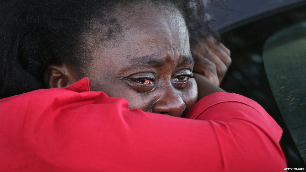 A woman cries at a treatment centre for Ebola near Monrovia, Liberia - Friday 22 August 2014