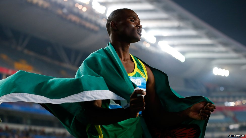 Zambian athlete Sydney Siame draped in the Zambian flag at the Summer Youth Olympic Games, China - Saturday 23 August 2014