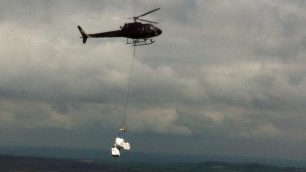 heather bales being dropped on moorland in Yorkshire