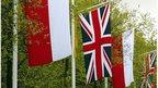 Polish and British flags alongside British roadside