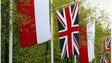 Polish and British flags alongside British roadside