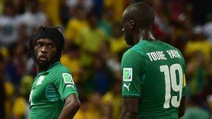 Ivory Coasts's Gervinho and Yaya Toure
