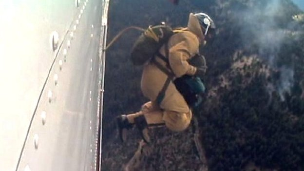 Smokejumper leaping from a plane