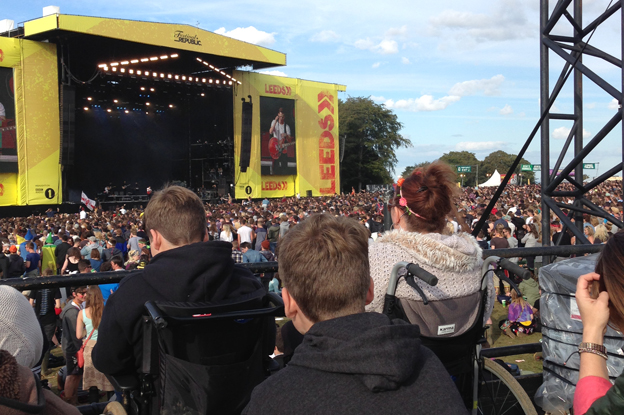 Disabled people sit on a raised viewing platform at the Leeds festival
