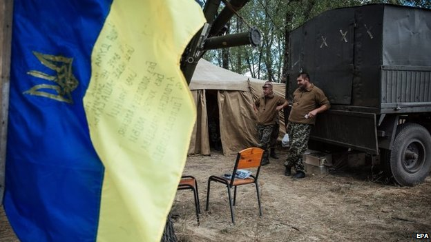 Ukrainian servicemen rest at their military camp near the eastern Ukrainian city of Debalcevo, in Ukraine, 29 August 2014