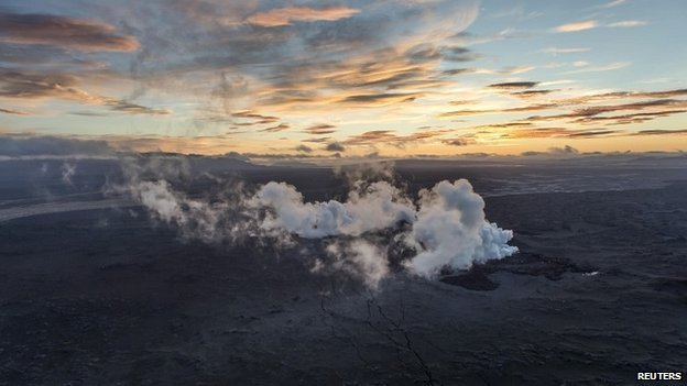 Steam rises over a 1-km-long fissure in a lava field north of the Vatnajokull glacier, which covers part of Bardarbunga volcano system - 29 August 2014