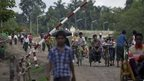 People pass through a security checkpoint in Maungdaw, northern Rakhine state, Myanmar - 14 September 2013