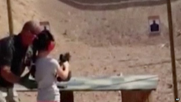 A still from the video of a 9-year-old girl shortly before she accidentally shot a man with an Uzi.