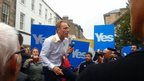 Jim Murphy is hit by an egg