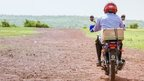 An eye surgeon on a motorbike in a remote region of Mali